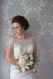 dark haired bride with soft romantic updo