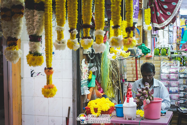 A man making flower garland @ Little India Brickfields KL