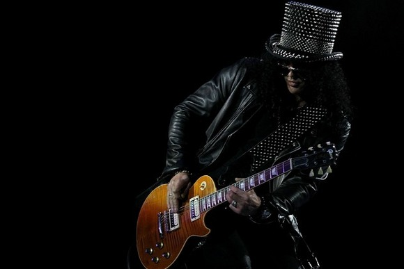 Slash playing the guitar