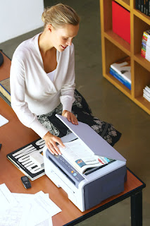 blonde woman using printer scanner