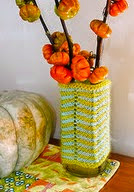http://www.ravelry.com/patterns/library/chevron-stitch-vase-cozies