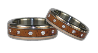 http://www.titaniumringshop.com/koa-with-gold-inlay-and-diamond-titanium-ring-set-p-859.html