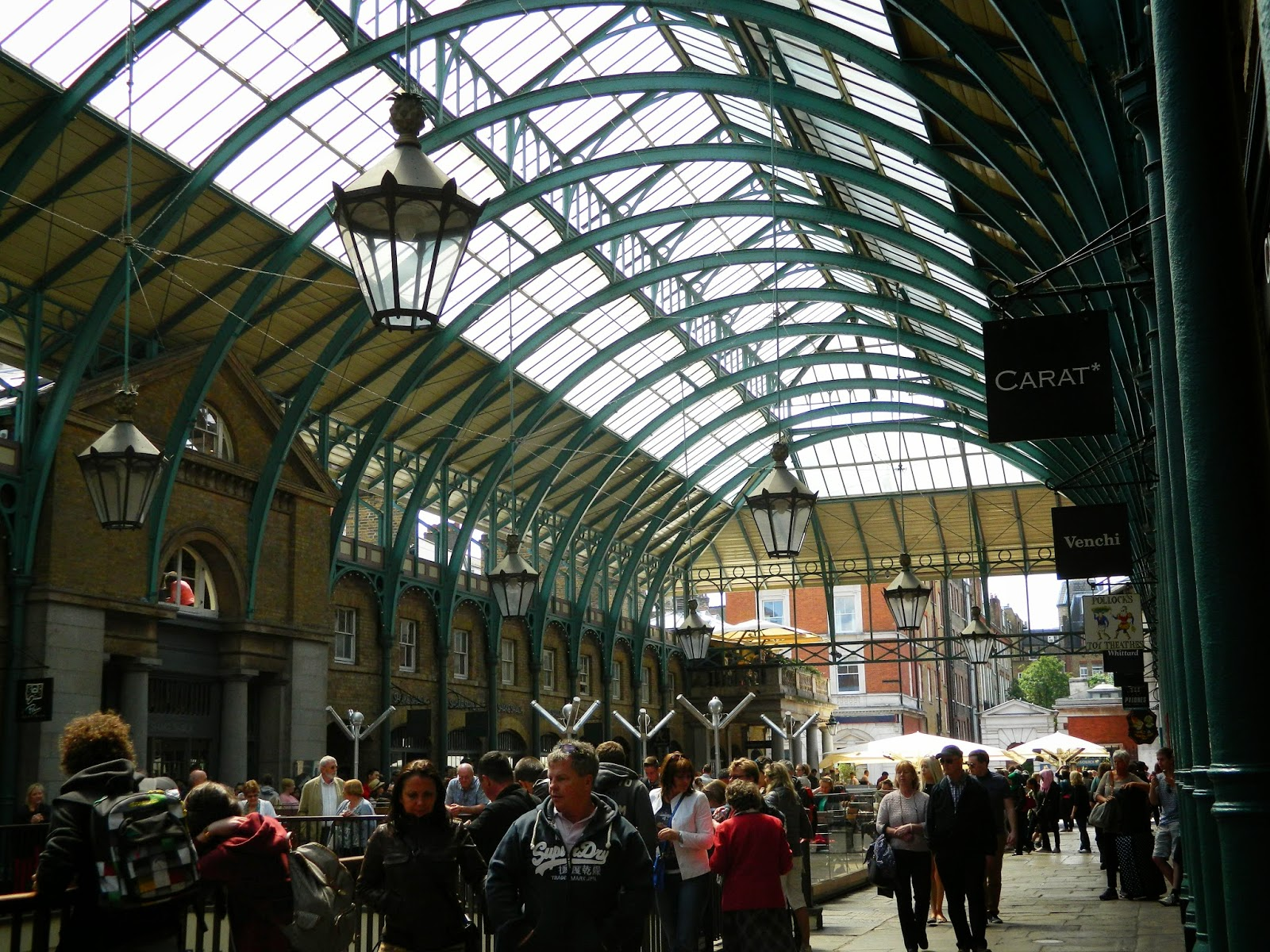 covent garden  architecture ceiling people green lights