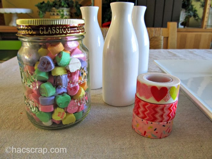 Supplies to make an Easy Valentine's Day Centerpiece: milk bottles, conversation hearts and washi tape