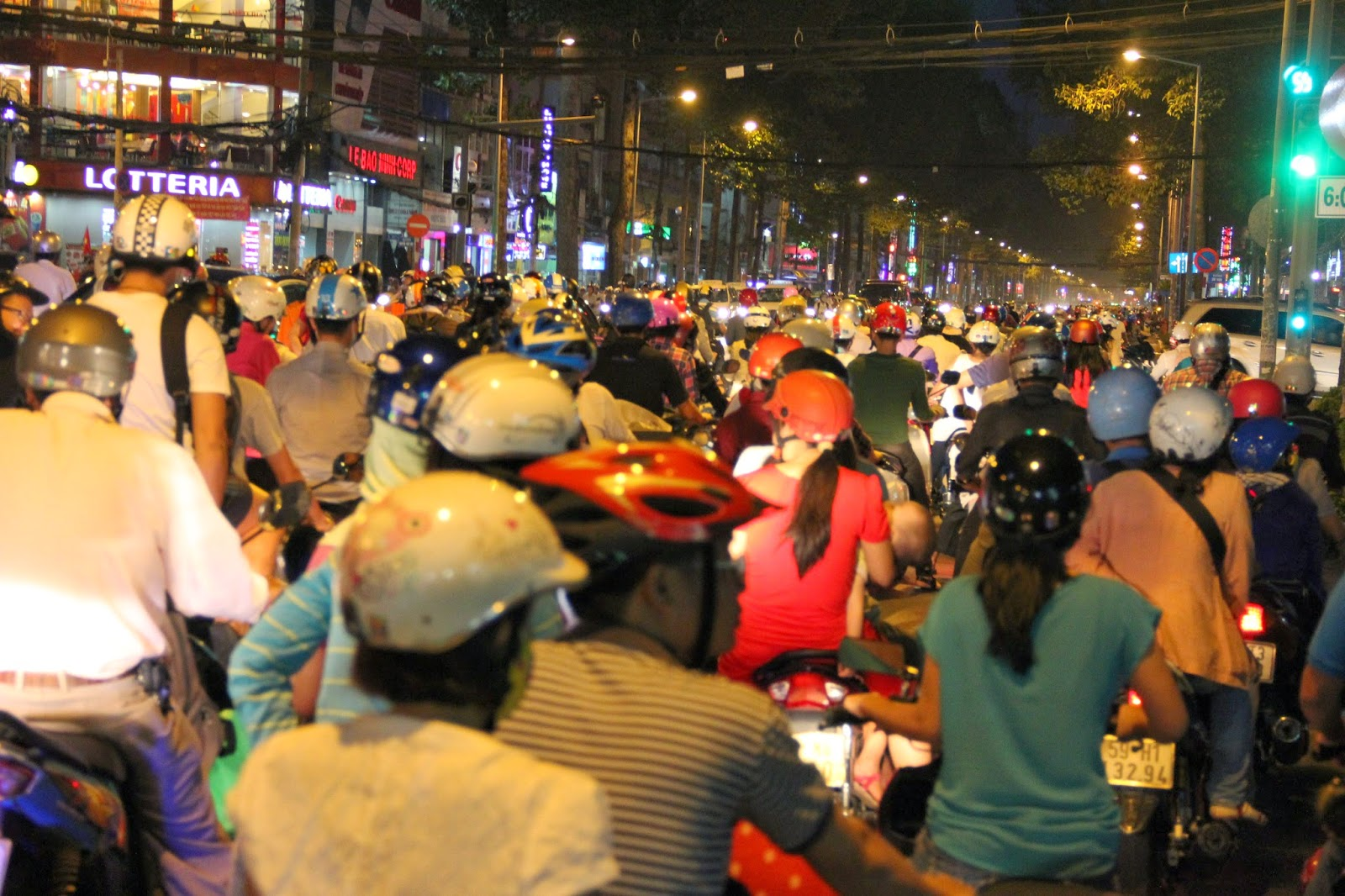 Joining the fray: what it looked like as a passenger riding a cyclo in the motorbike traffic in Ho Chi Minh City!