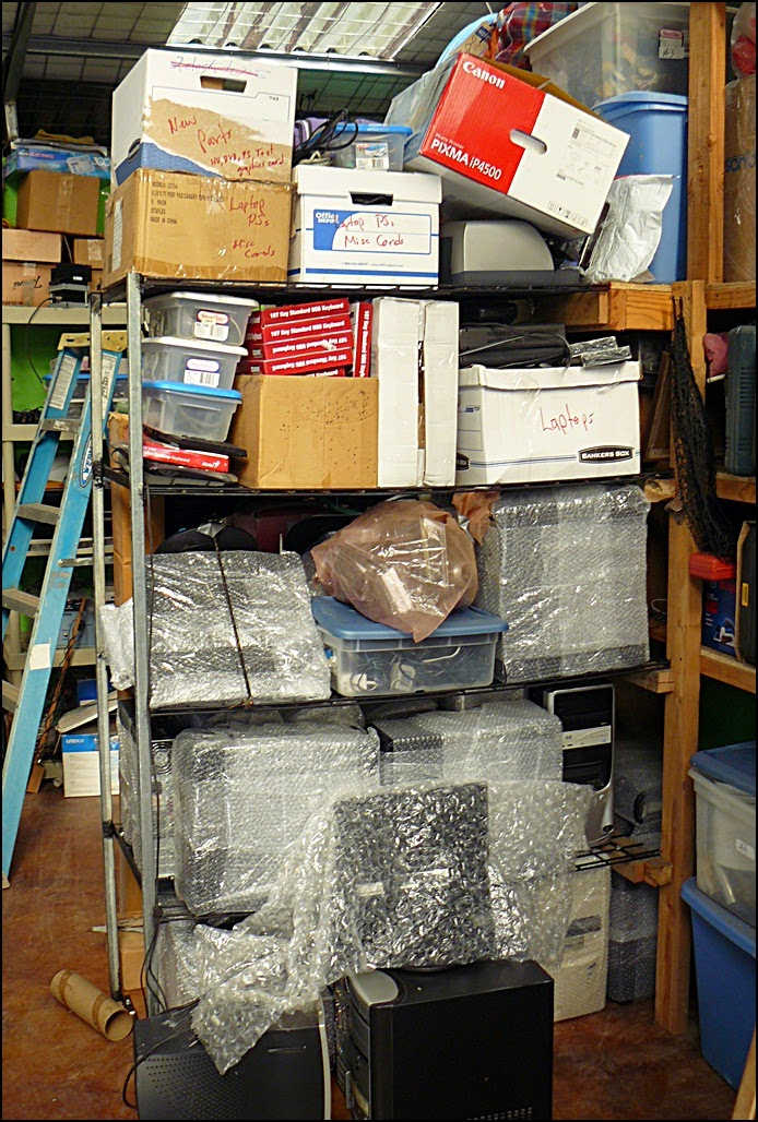 shelves of donated used PCs and related equipment
