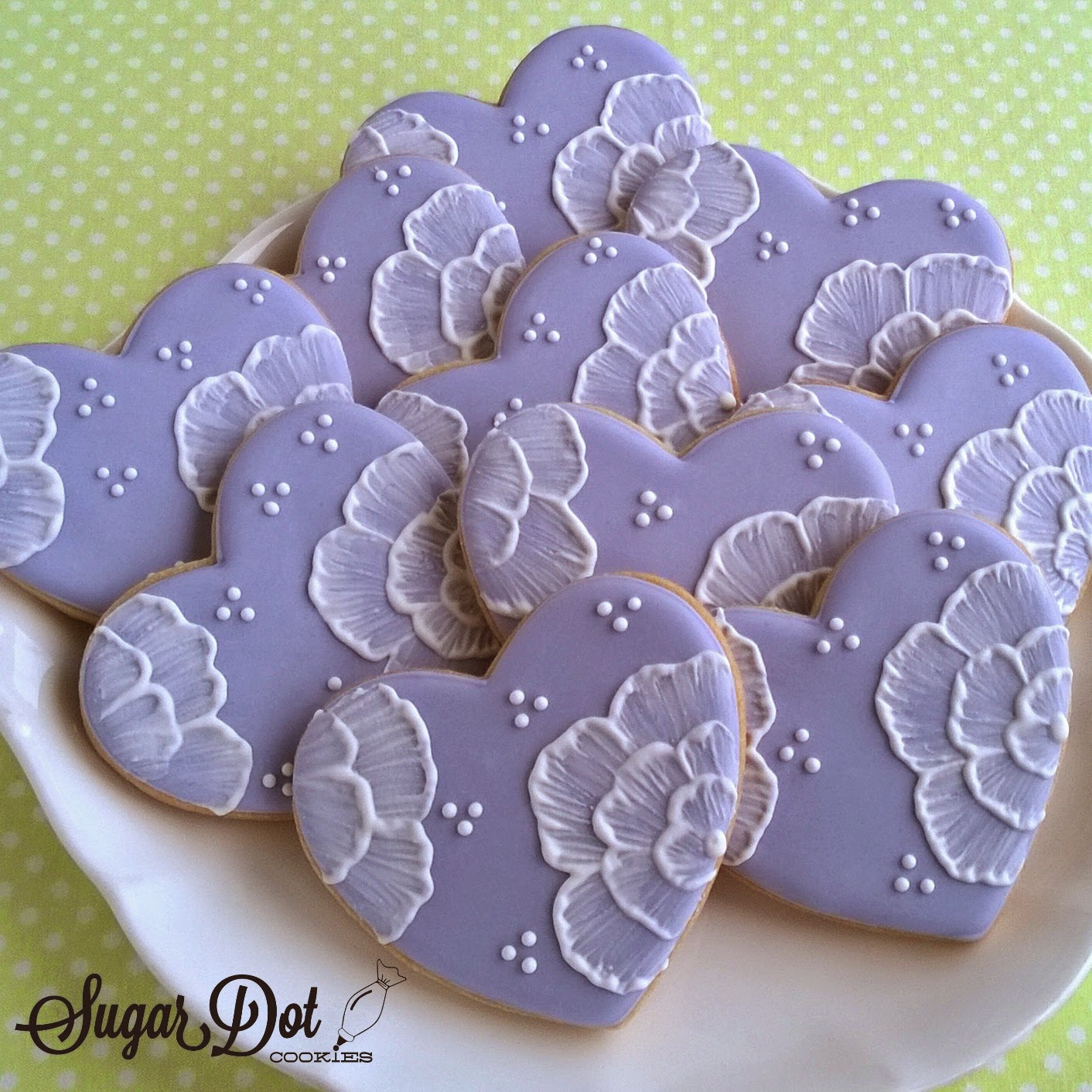 The flowers on these hearts were painted on with royal icing using a ...
