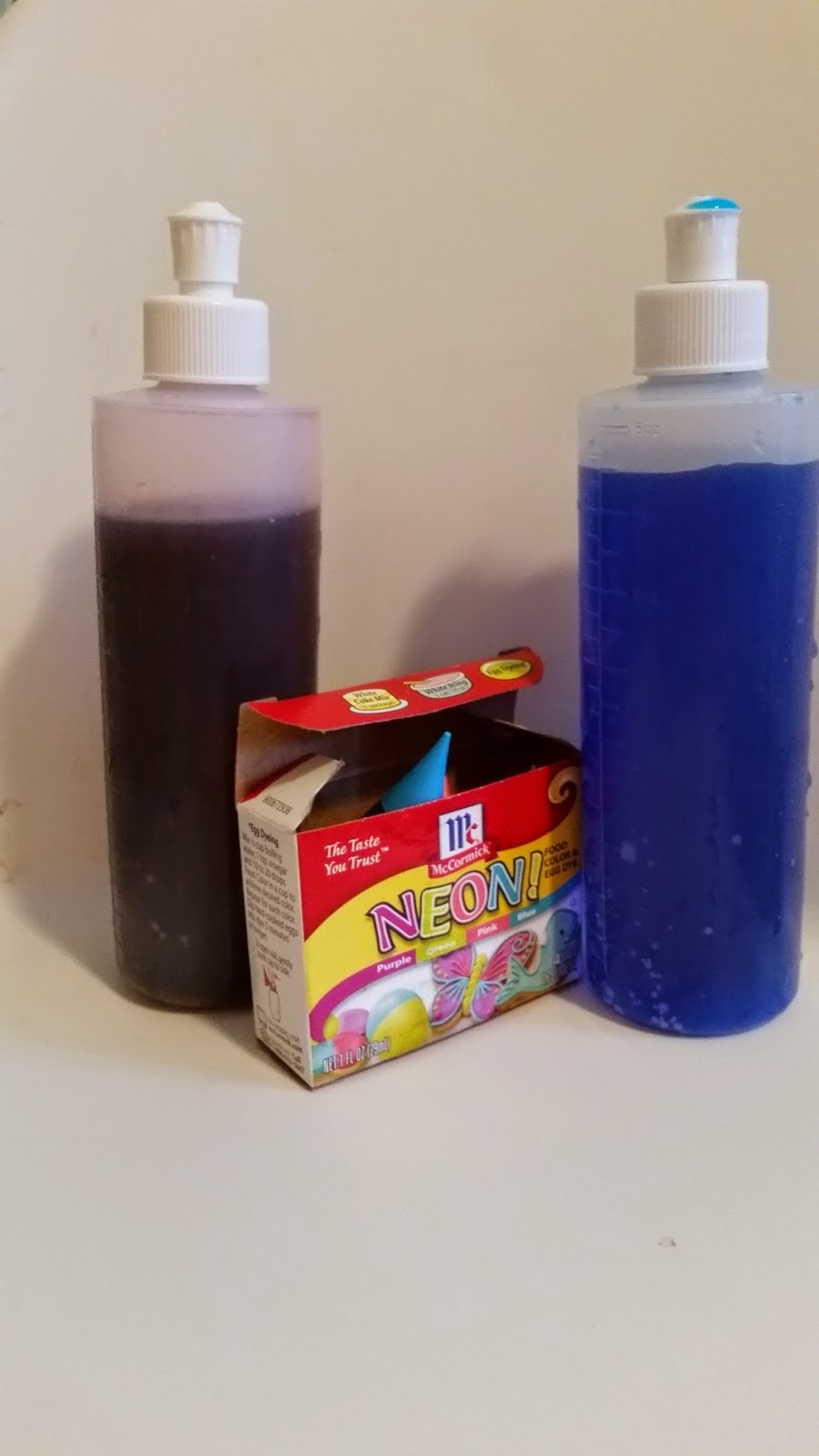 Peri bottles filled with water and a few drops of food coloring (or liquid watercolor) work well with indoor snow play