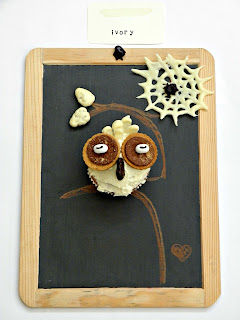 Owl cupcakes and chocolate spiders inspired by the color ivory.