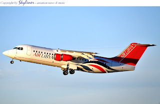 Air Libya's ARJ100 in new livery.