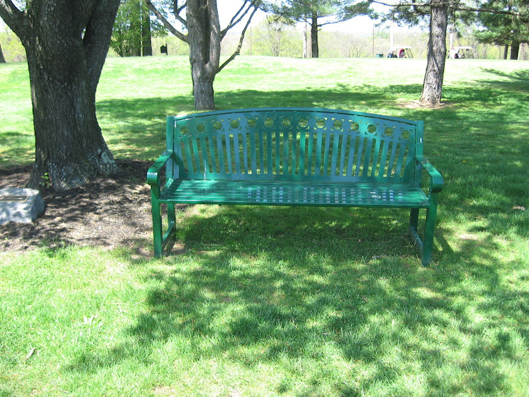 Water Ineson's Memorial Bench Near the 18th Green and The 19th Hole