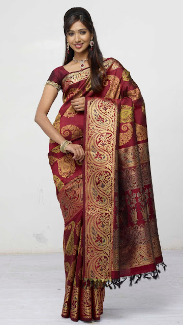 Marriage sarees,New Saree,New sarees,Sarees,Saree, wedding sarees, kanchipuram silk sarees,Kanch Pattu Saree,New Indian Designer Collection of Bridal Sarees ,Cotton Sarees, Cotton Designer Saris,Cotton Sarees,bridal saree, wedding sari, party wear sarees, traditional indian sarees like zari, silk, printed,A perfect example of a traditional kanchipuram sari with a traditional look..yet elegant and stylish. I would love to accesorize like the lady in the picture above if I wear a Kanchipuram sari.. The pallu of this sari is really gorgeous with a lady standng in a red sari all hand woven and this sari is a very expensive one..I guess it costs more than  I simply adore this sari for its beautiful combination of colour, Orange and purple I'm still hunting for this combination but could not get the exact combination. This is simply adorable!!! another sari from RMKV silks.  This is a readymade sari for your little angel. This is a pure kanchipuram silk sari customized as a ready to wear outfit for small kids. I'm sure your little one's will be excited to wear this kutti pattu.. means saree for kid  The sari above is called the muppagam pattu the latest trend in Kanchipuram saris. You can see the border of the sari and the body in almost the same width. This sari is from Mahaveers a popular shop in Coimbatore THIS ONE IS A GADHWAL SILK, MY FAVOURITE BLUE.MY MOM IN LAW GIFTED ME. Sarees are the elegant and the sexiest outfit for Indian women. A lady looks very graceful and elegant in a saree.There are wide range of sarees in different materials and designs and work. The designer crepe,georgette and chiffons are popular these days and when it comes to a formal occassion my personal choice definitely would be traditional sarees specially kanchivaram sarees.One can choose kanchivaram sarees as per their own taste.The variety ranges from simple,elegant sarees to a very grand saree and the price range vary with the zari work in the saree. A simple saree with minimum zari work will cost any where between 3000 to 4500 INR, and the maximum range goes beyond 60,000 and sky is the limit.But one can definitely buy a good elegant saree with price range anywhere between 5000 to 10,000INR.Nowadays one can buy a plain kanchivaram saree without any zari work and one can design as per their taste.There are ladies in Chennai to design these kind of sarees as per their customer's choice.One can customize these plain sarees with kundan,zardoshi or any other design one prefer.But my personal choice  would be the traditional kanchivaram saree with it's zari work.They have their own grace.There are kanchivaram silk skirts available for cute little girls and teenage girls.If you have a girl baby you should definitely try these skirts and I swear your child will look like goddess lakshmi in this outfit.Teenage girls can wear half saree and blouse with kanjivaram silk skirt when they go for a formal function and can wear simple gold bangles, a choker and a pair of jhumkas and can wear asimple tikka(netthi chutti), definitely you will get loads of compliments for sure.For ladies wearing saree they can wear traditionalstonned necklace like ruby,emerald and blue sapphire to match your saree or there are wide range of 1 gram gold ornaments available in the market and you can choose from that according to your budget.I will give a list of names of shops from wher you can purchase good kanchivaram sarees,gold jewellery and artificial and one gram jewellery