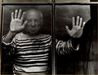 Picasso with hands pressed against window pane