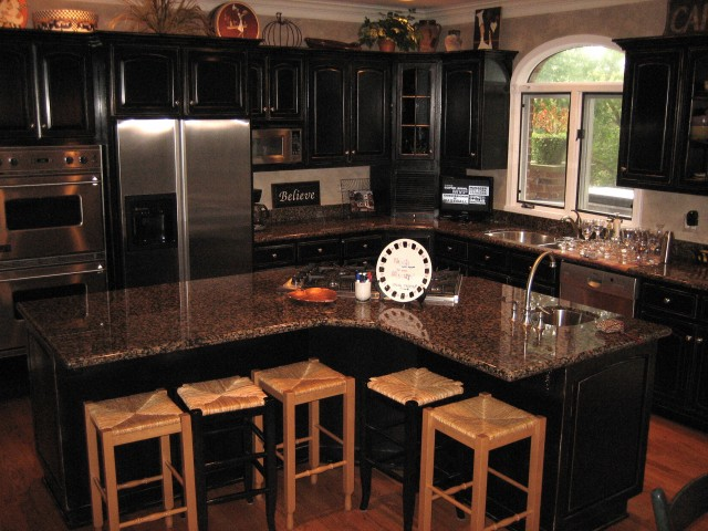 Kitchen trends distressed black kitchen cabinets for Dark cabinet kitchen ideas