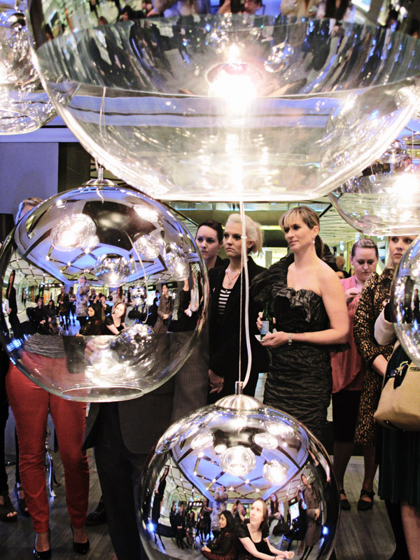 Pommery Champagne Cube Westfield Sydney, Retro Mirror Ball lights, and crowd listening to the launch speeches.