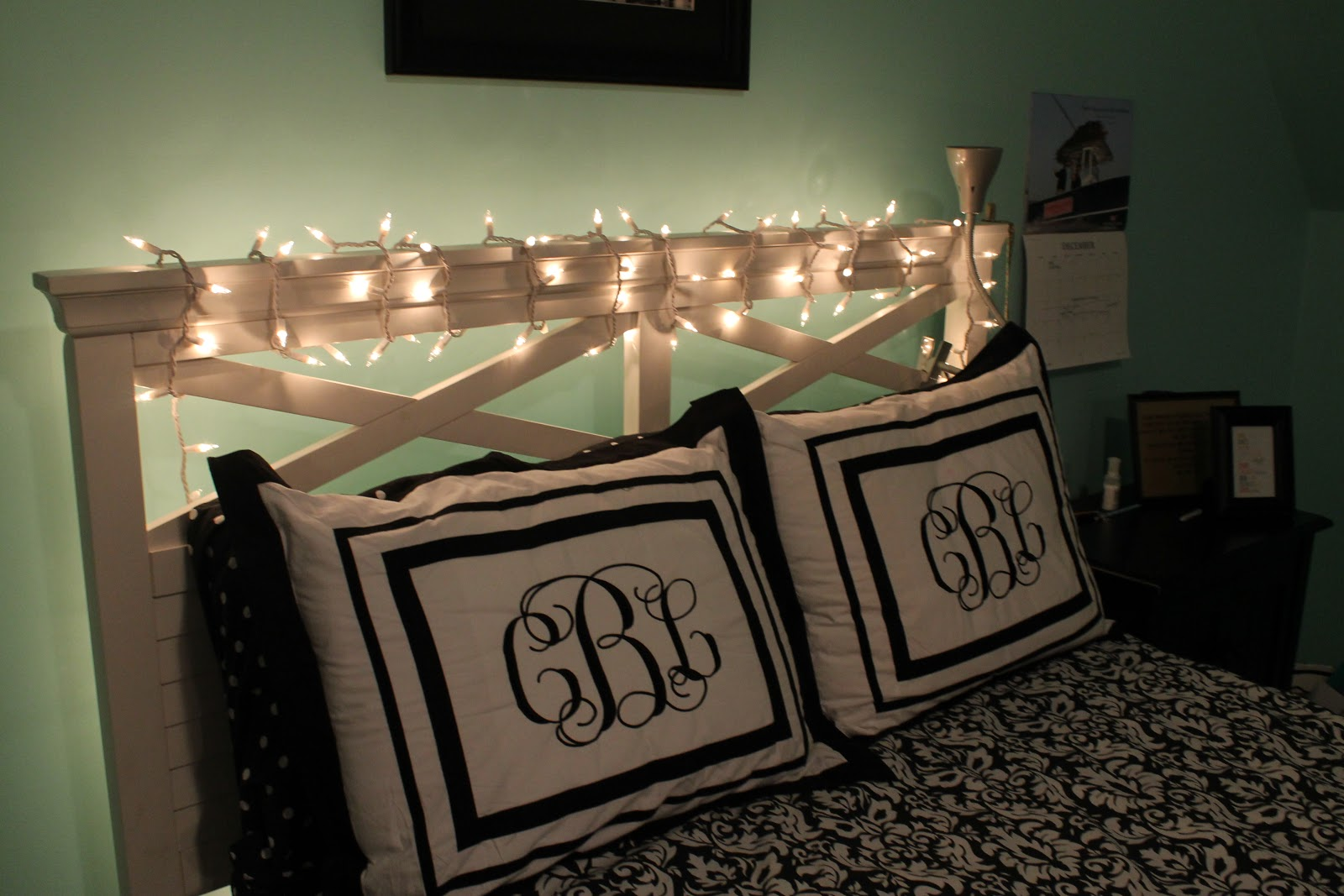 First off  I have my bedframe wrapped in holiday lights  These are so  pretty and I keep them on until the minute I fall asleep. Behind Her Monogrammed Macbook  Decorating My Room for Christmas