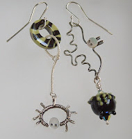 Spider and bat Halloween earrings with crystals and porcelain handmade beads.