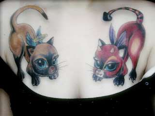 Tattooed Girl with Chest Tattoo - Good and Evil Cat Tattoos
