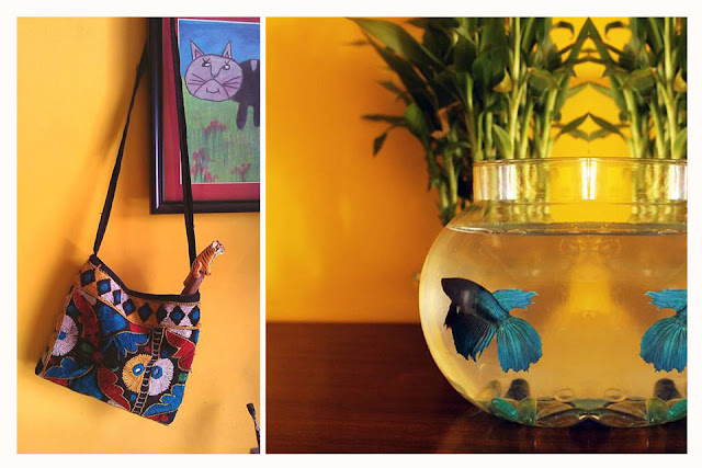 yellow wall, child art, fish bowl
