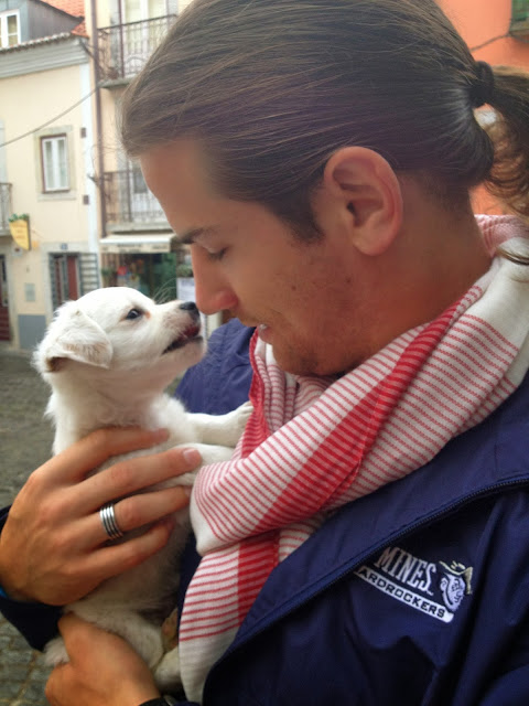 Jonathan and a puppy in Lisbon on Semi-Charmed Kind of Life