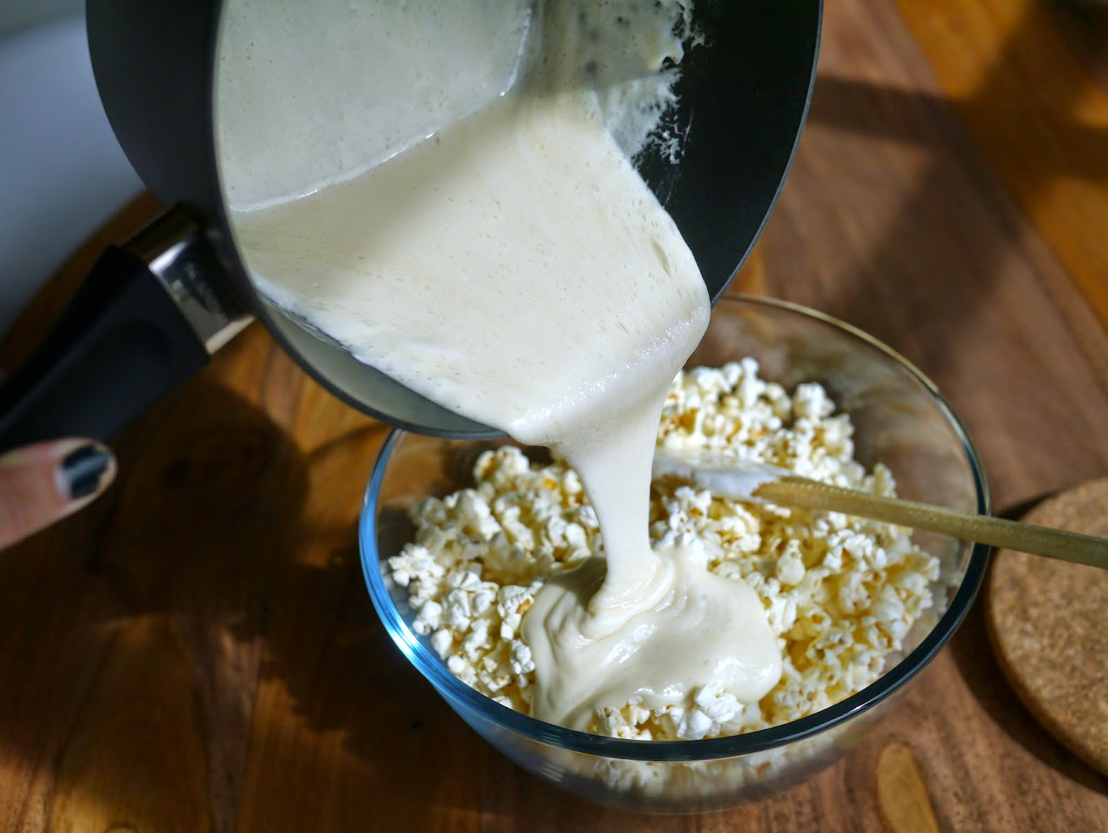 remove the marshmallow mix from the heat and pour over the popcorn