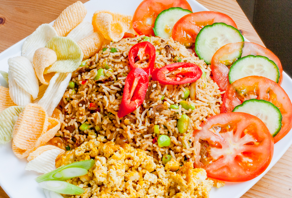 Indonesian Nasi Goreng served with Veggie Chips, Slices of Cucumber ...