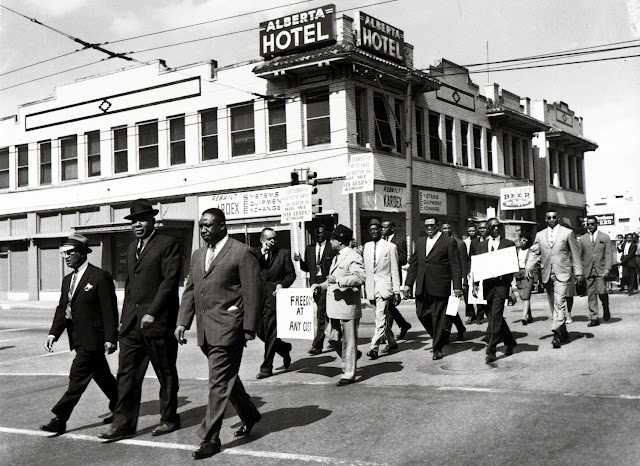 Marion Butts, NAACP Picket, Front row: (left to right) C. Jack Clark, Travis Clark, Roosevelt Johnson; Second row: C. B. Bunkley,, unknown, George Allen; Third row: Tony Davis; Fourth row: (right) Pettis Norman; Fifth row: Frank Clark, Dallas, Texas, 1965. Courtesy Documentary Arts Collection/International Center of Photography.
