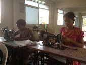 women sewing new fabric