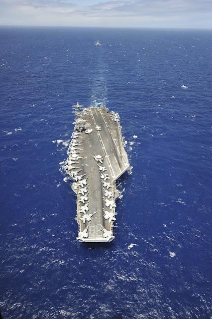 The aircraft carrier USS Nimitz (CVN 68) participates in the Great Green Fleet demonstration