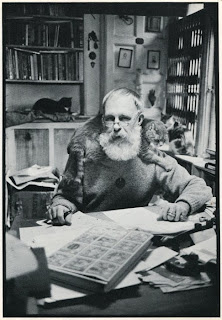 Edward Gorey with his cats writing