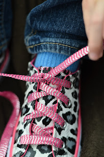 learning to tie shoes; laces pulled incorrectly