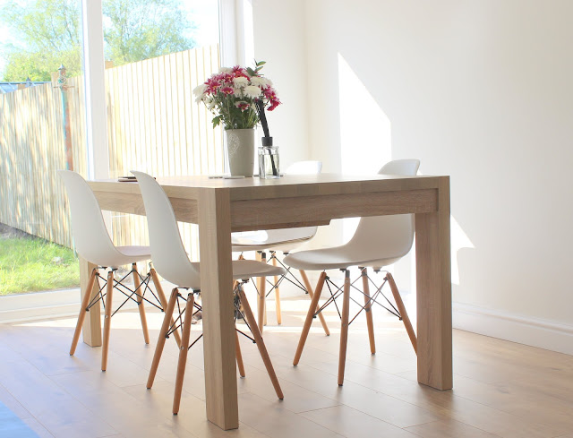 Wooden dining table and white chairs