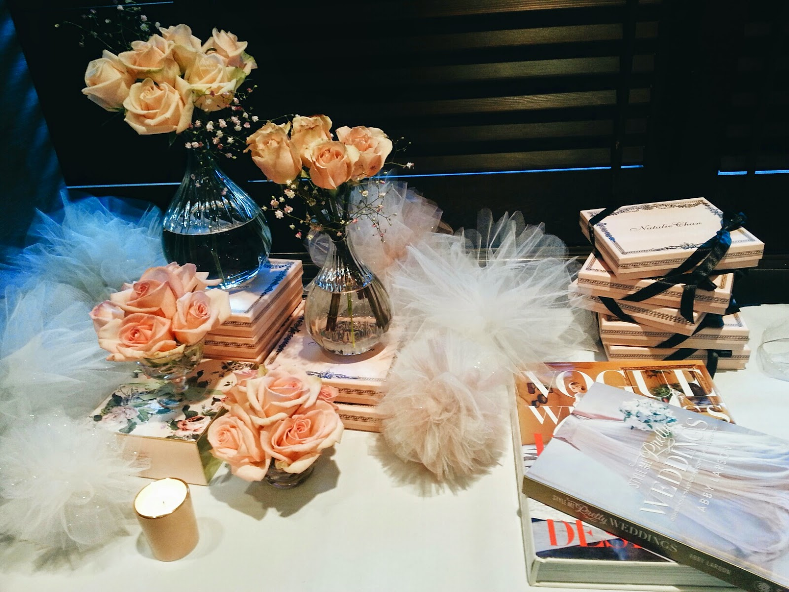 Portrait of a lady behind the scenes natalie chan boutique a display table lined the side of the room displayed with a plethora of our favourite things roses beautiful books tulle pom poms and a stack of our new izmirmasajfo Gallery