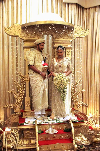 Bride and groom in traditional costumes, Sri Lanka