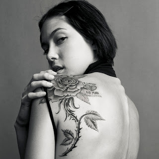 Tattooed Girl with Rose Flower Tattoo Design on Back