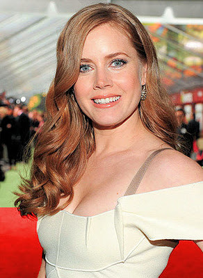 Amy Adams showing that the drapes match the carpet