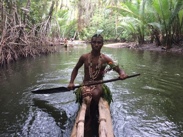 Canoeing through the mangroves near Tufi, Papua New Guinea