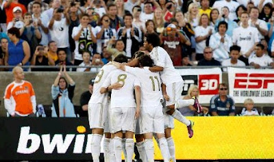 Template of Real Madrid celebrates a goal at Los Angeles Memorial Coliseum