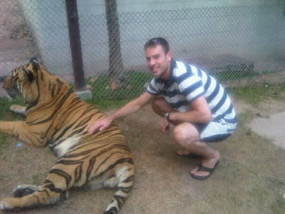 Simon stroking a tiger