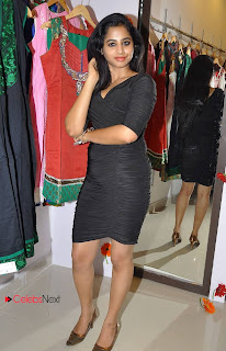 Swathi Deekshith Stills in Black Short Dress at Barikha Fashions Showroom 0043