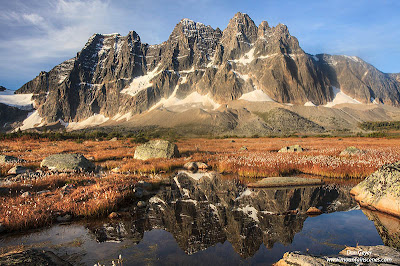 The Ramparts reflected in a tarn near Amethyst Lakes in Tonquin Valley, Jasper National Park, Alberta, Canada.