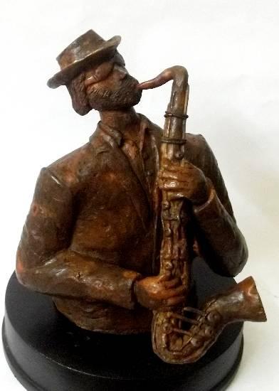 Musician, bronze sculpture by Chandan Roy ( see Chandan Roy's portfolio of bronze sculptures on www.indiaart.com )
