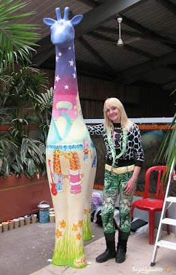 Ingrid Sylvestre artist with Nextra-terrestrial in the Giraffe House Colchester Zoo