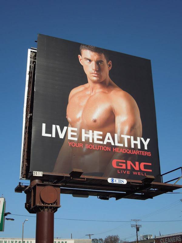Live Healthy GNC male model billboard