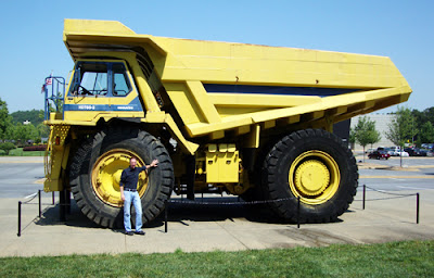 tourATLANTA author, Travis, with a Komatsu Truck