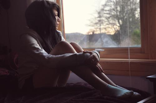 Sad alone girl in rain