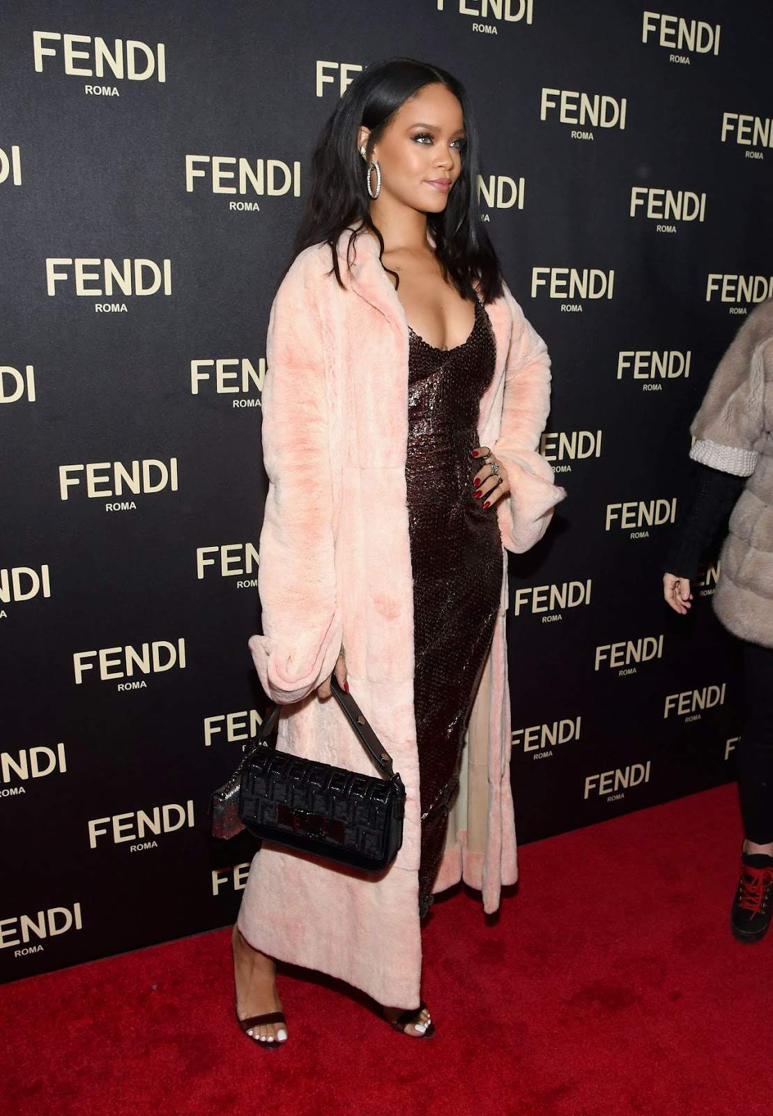 Rihanna in a slinky dress at the Fendi New York Flagship Boutique Launch Party