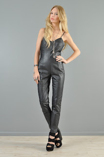 Vintage black leather one piece jumpsuit with lace back closure.
