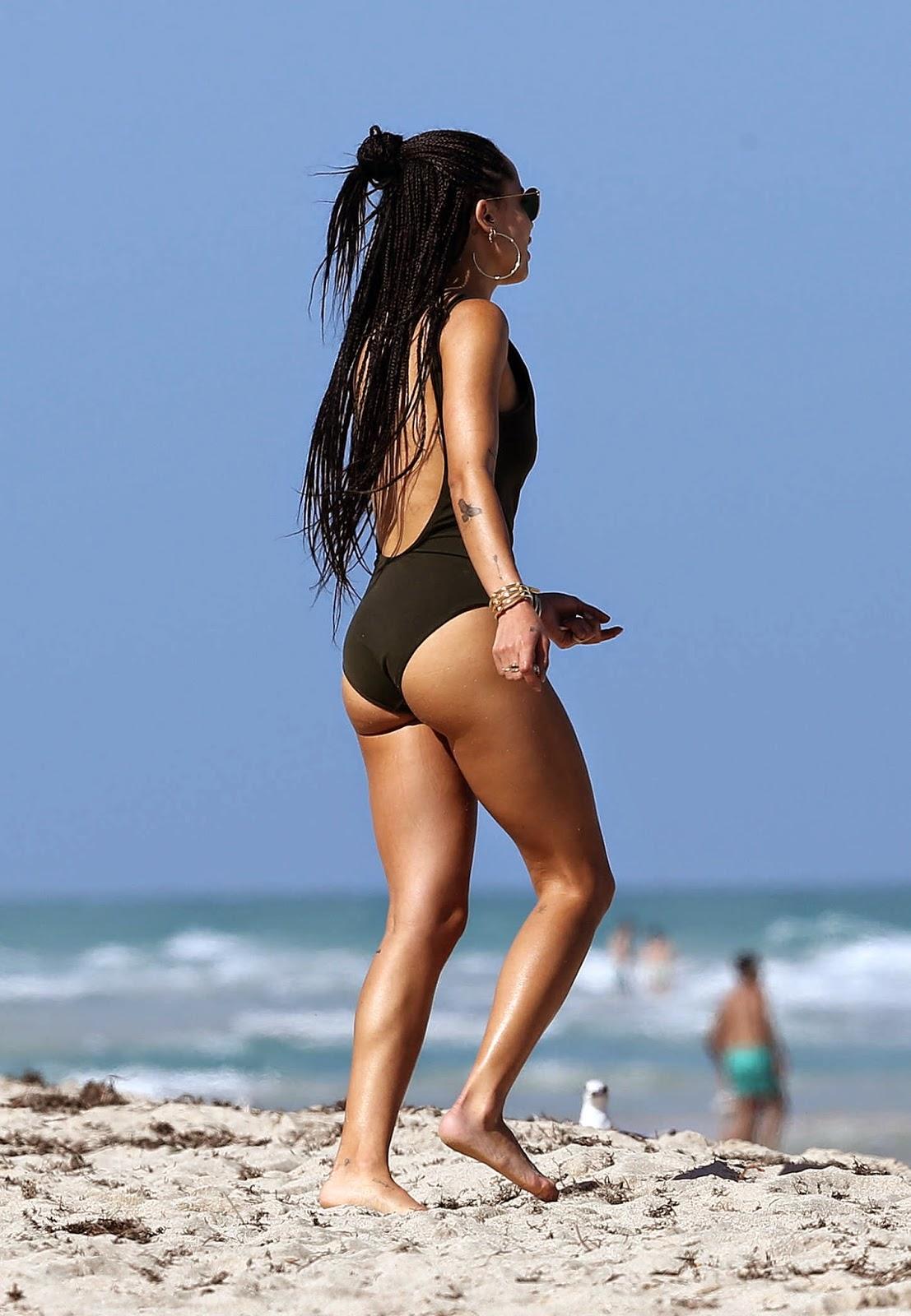Zoe Kravitz flaunts pert derriere in a black swimsuit in Miami