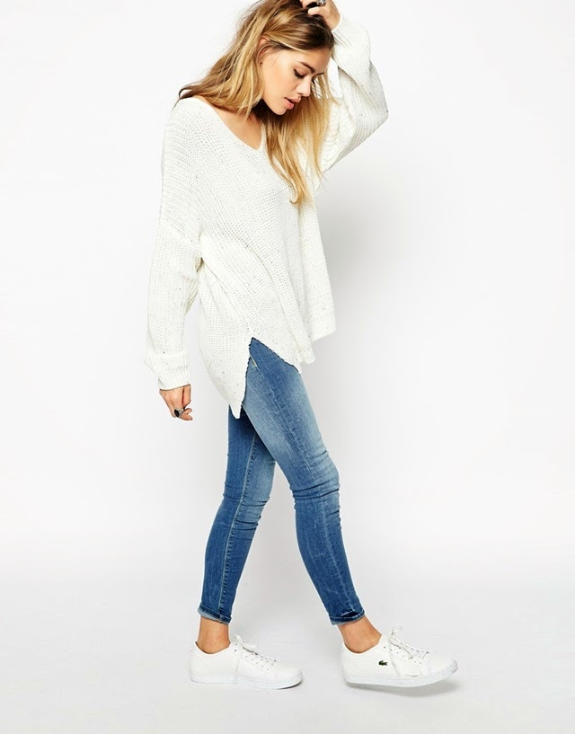 casual cozy outfit. white chunky knit vneck sweater , skinny jeans and white low top sneakers